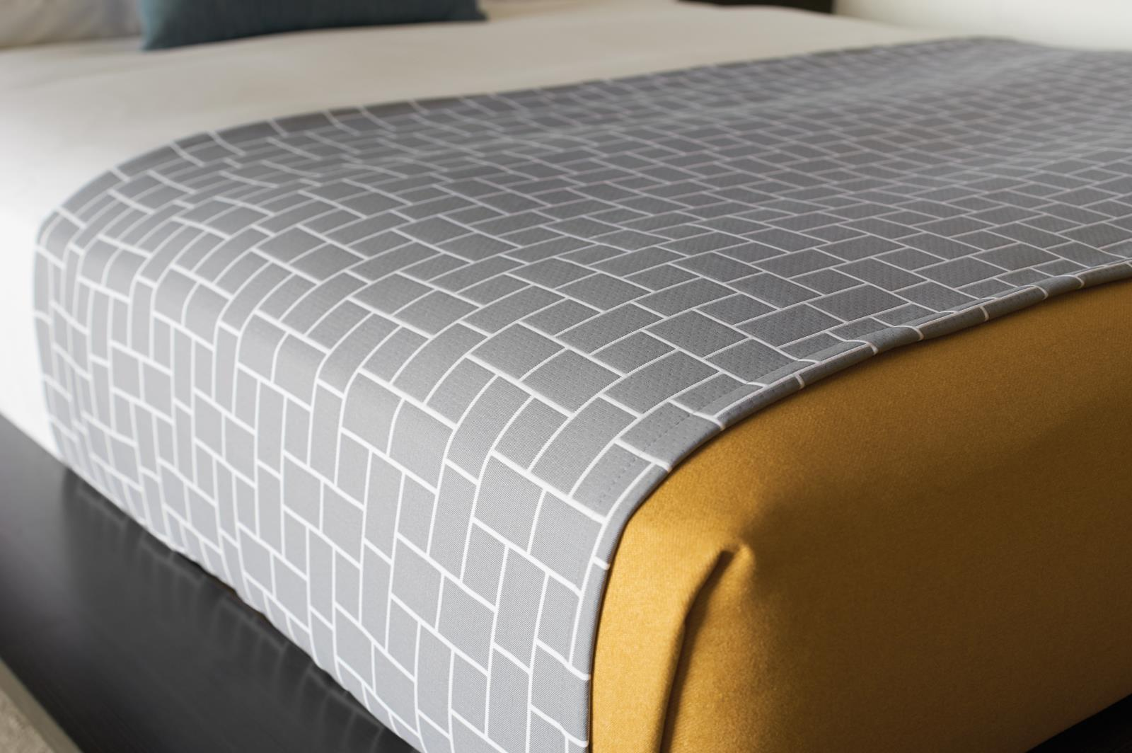 Domino grey Fabricut bedding in hospitality room