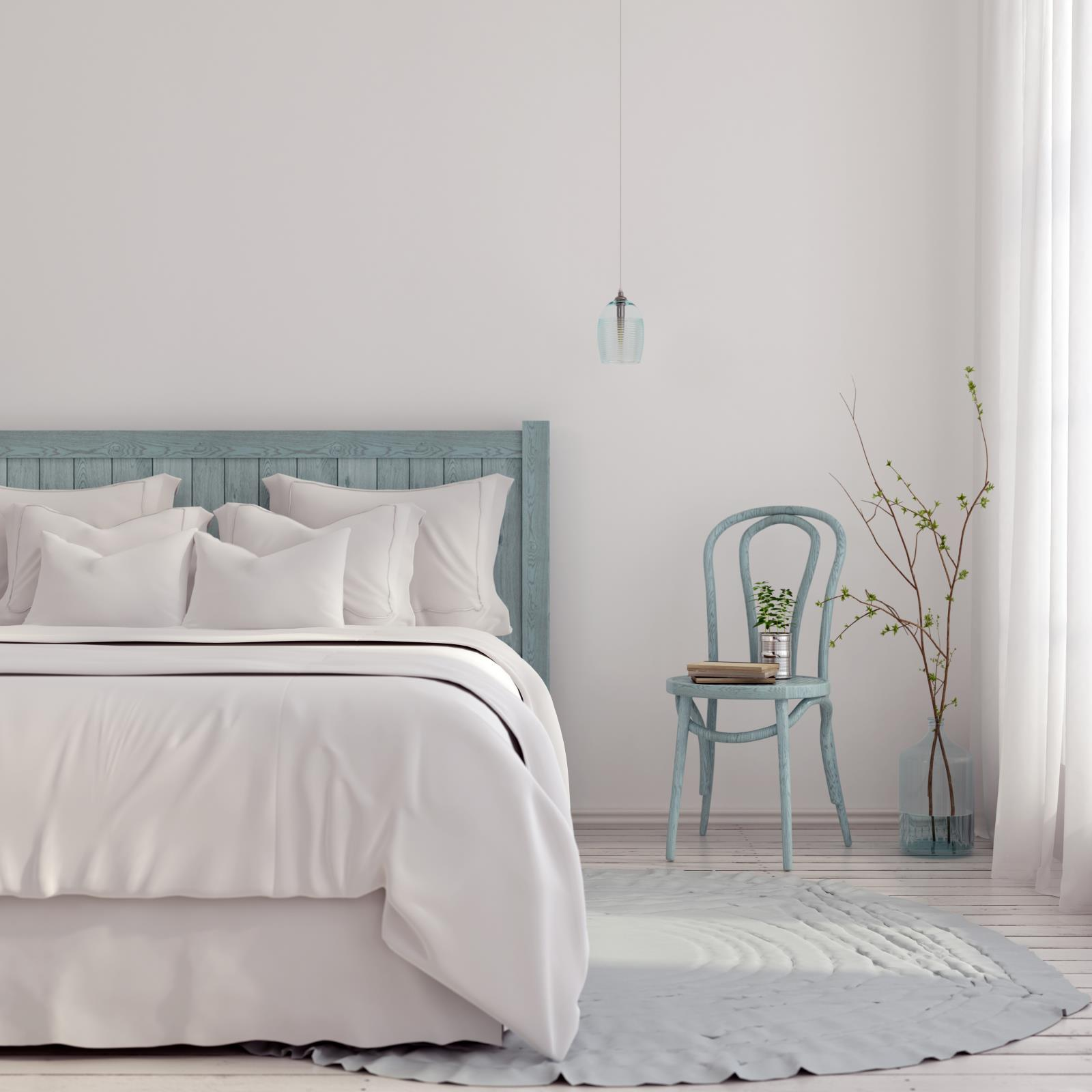 Bedroom with teal and neutral bedding